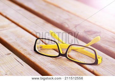 Colorful Eyeglasses on a Park bench outdoor object
