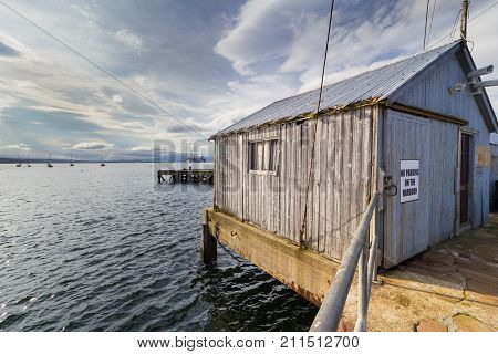 An old wooden harbour shack, Munlochy, Scotland