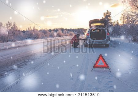 Broken car on a snowy winter road