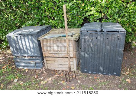 Compost Bin In The Garden Composting Pile Of Rotting Kitchen Fruits And Vegetable Scraps