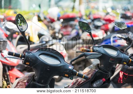Chengdu, China - July 31, 2017 : Electric scooters in a parking in Chengdu, Sichuan Province, China