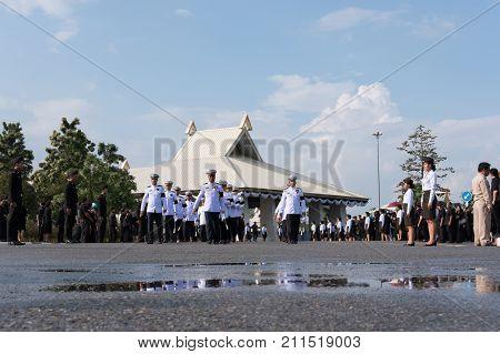CHIANG MAI, THAILAND - OCTOBER 26: Thai government official walk to present Sandalwood flowers as a final tribute to His Majesty The Late King Bhumibol Adulyadej before royal cremation ceremony at Chiang Mai International Exhibition and Convention Centre