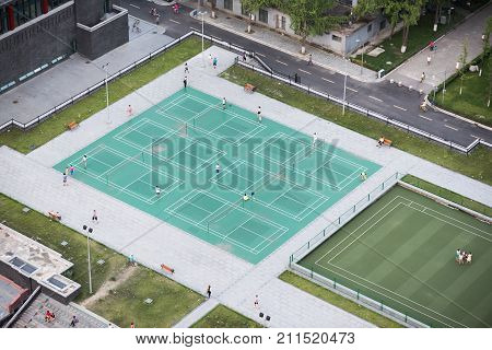 Chengdu, China - Aug 23, 2017 : Aerial view of chinese people playing badmington in Huaxi Sichuan University Campus in Chengdu, Sichuan Province, China