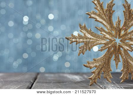 golden snowflake with brilliant background