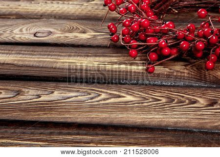 european holly on a wooden board