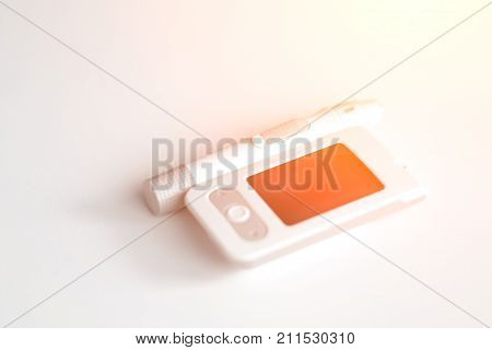 Medicine, Diabetes, Glycemia, Health Care And People Concept - Glucose Meter And Lancet Device For T