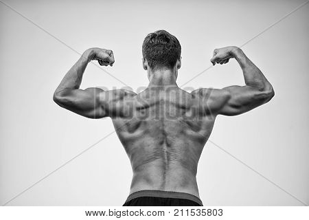 Bodybuilder Showing Muscles, Biceps And Triceps