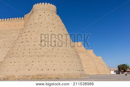Wall of the massive Ark fortress, located in the city of Bukhara, Uzbekistan. The Ark is a large earthen fortification located in the northwestern part of contemporary Bukhara