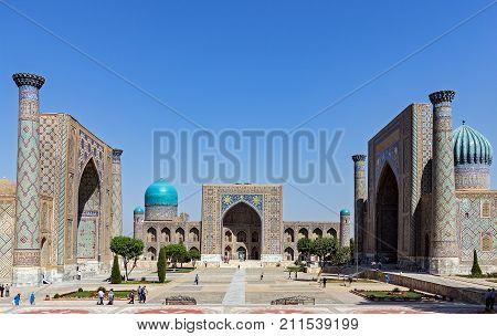 Panoramic view of Registan square - Samarkand, Uzbekistan - The three madrasahs of the Registan are : the Ulugh Beg Madrasah, the Tilya-Kori Madrasah and the Sher-Dor Madrasah.