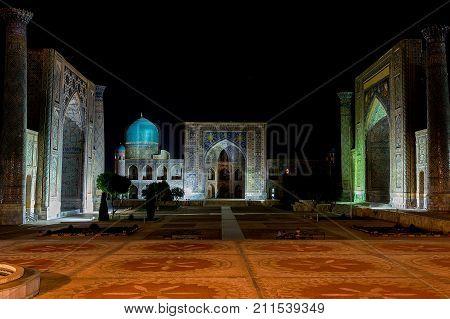 Panoramic view of Registan square at night - Samarkand, Uzbekistan - The three madrasahs of the Registan are : the Ulugh Beg Madrasah, the Tilya-Kori Madrasah and the Sher-Dor Madrasah.