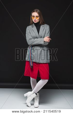Woman In Autumn Outfit With Crossed Hands