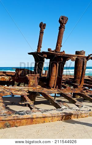 in australia fraser island the antique rusty and damaged boat and corrosion in the ocean sea poster