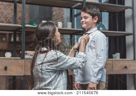 Mother Tying Necktie On Son