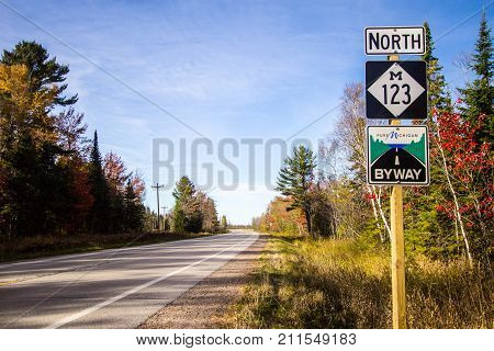 Paradise, Michigan, USA - October 19, 2017: Road sign for M 123 in the Upper Peninsula. The highway is designated as a Pure Michigan Scenic Byway and is part of the scenic Lake Superior Circle Tour.