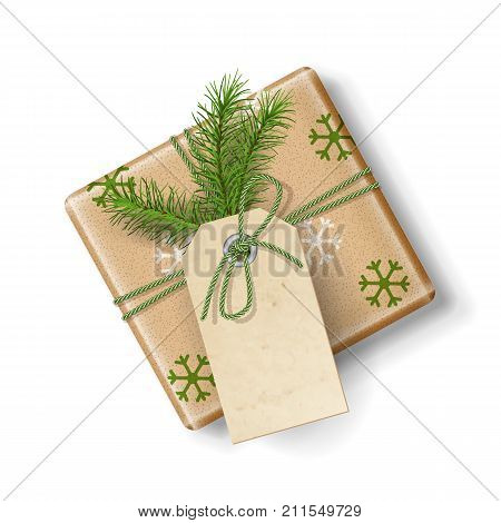 Wrapped vintage Christmas vector gift box with fir tree branch, isolated on white. Top view on Xmas gift with blank label