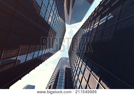 Low angle view of skyscrapers. Skyscrapers at sunset looking up perspective. Bottom view of modern skyscrapers in business district in evening light at sunset. Business concept of success industry tech architecture. 3D rendering