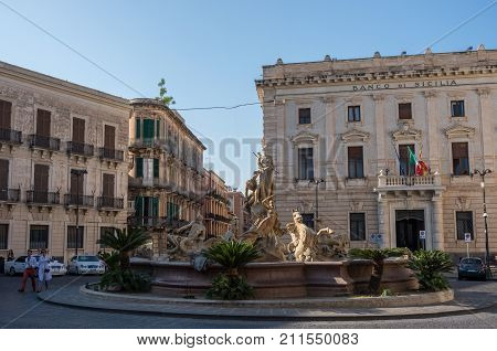 Syracuse, Italy - August 31, 2017: The fountain of Artemis (Diana) on the square Archimedes in Syracuse.