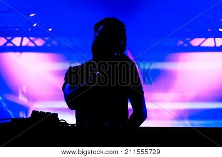 Black Silhouette of music deejay at the party