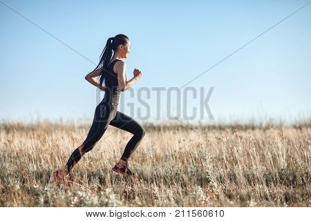 Asian Girl In Sportswear Running Across Field, Morning Workout