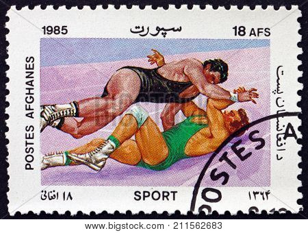 AFGHANISTAN - CIRCA 1985: a stamp printed in Afghanistan shows wrestling combat sport circa 1985