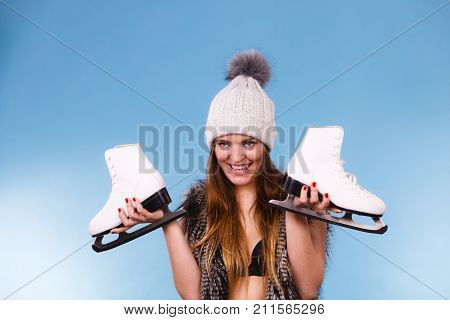 Woman Wearing Bra And Holding Ice Skates