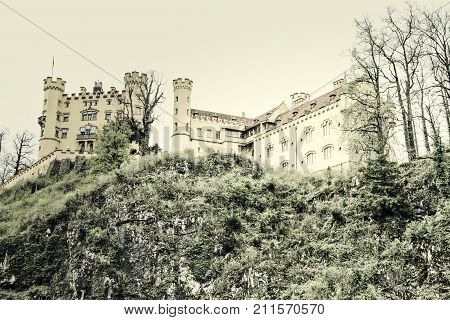 Hohenschwangau castel in the Bavarian alps with the sky as copy space.