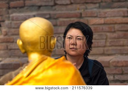 Thai buddhism people in buddhist pray for benefaction worship to Buddha at Thai temple (Wat Thai)