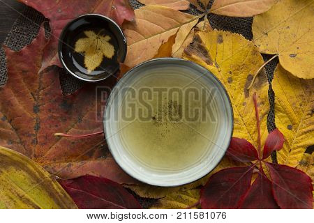 Beautiful autumn tea time ceremony still life top view closup background
