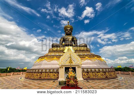 The biggest Phra Phuttha Maha Tammaracha black buddha statue at Pechabura Buddhist Park in Petchabun Provice Thailand