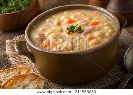 A bowl of delicious hearty yellow split pea soup.