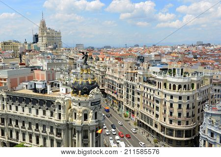 MADRID - JUN. 6, 2013: Aerial view of Madrid City at the Calle de Alcala and Gran Via, Madrid, Spain. Metropolis Building Edificio Metropolis and Telefonica Building are at both sides of Gran Via.