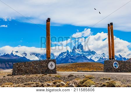Patagonian pampas. Symbolic columns on the road to Los Glaciares National Park. Fine highway to the grandiose Mount Fitz Roy. The concept of active and ecological tourism