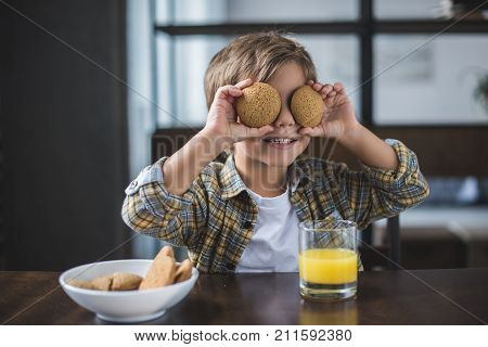 Little Boy Holding Cookies