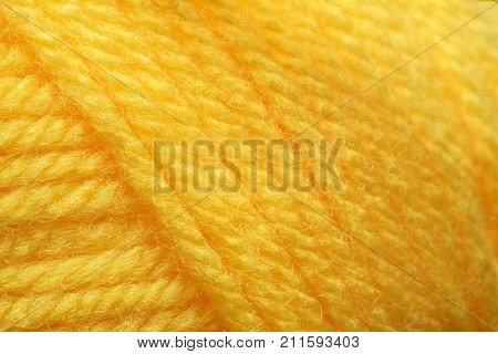 Wool yarns for knitting. Close-up Yellow color