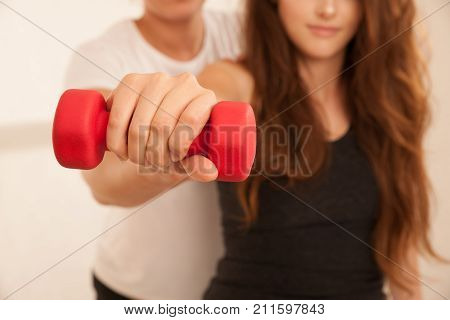 Physiotherapy - Young Woman Making Arm Exercises With Therapist For Rehabilitation Of Injured Arm