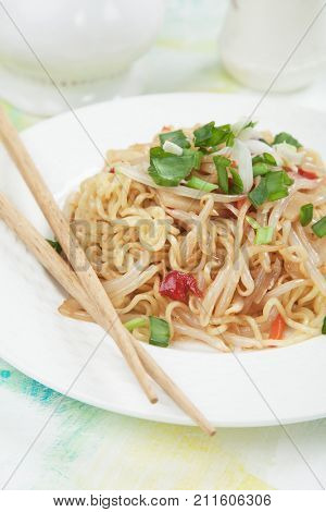 Asian instant noodles with soybean sprouts, spring onion and peppers