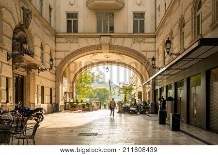 BUDAPEST HUNGARY - SEPTEMBER 26, 2017: City passage.  People on a pedestrian passage from street Vaci utica through an arcuate building in Budapest Hungary on September 26, 2017.