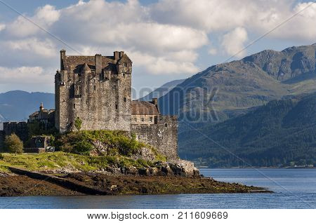 View of the Eilean Donan Castle in the Highlands of Scotland United Kingdom; Concept for travel in Scotland