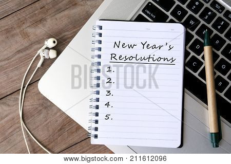 New Year's Resolutions Written On Paper On Top Of Laptop Keyboard
