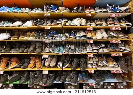 SAINT PETERSBURG, RUSSIA - CIRCA OCTOBER, 2017: shoes on display at Quicksilver store in Saint Petersburg. Quiksilver, Inc. is an American retail sporting company.