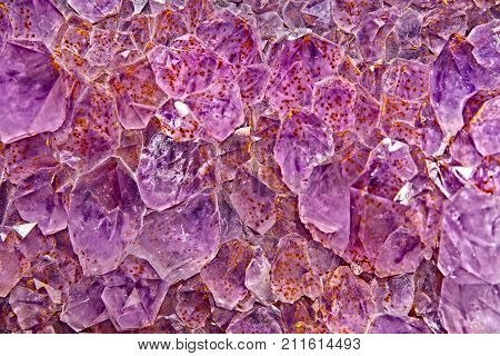 Purple to pink Amethyst crystal geode as texture or full frame background.