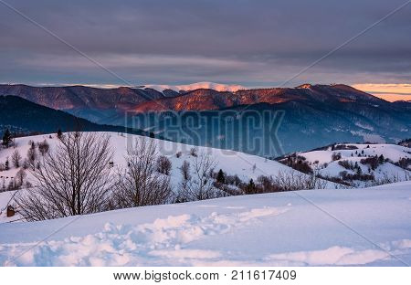 Mountain Ridge With Snowy Top At Sunrise