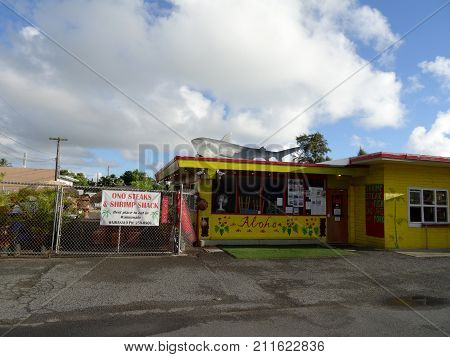 Waimanalo Hawaii - July 11 2016: Ono Steaks and Shrimp Shack yellow building with shark on top.
