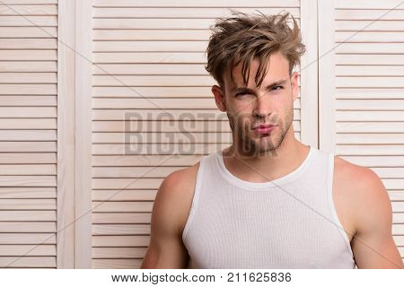 Man With Fair Hair On Light Wooden Planks Background.