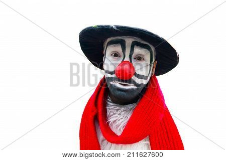 Funny clown isolated on white background. Man comedian in the outfit. Circus performer laughs.