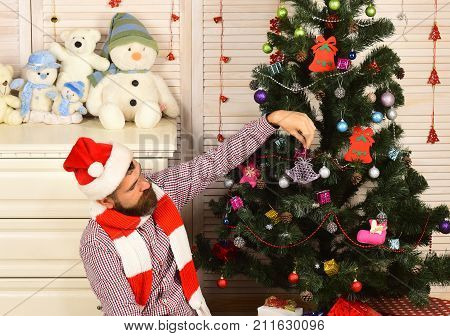Santa Claus With Interested Face Near Bureau And Christmas Tree