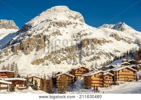 Alpine winter mountain landscape. French Alps covered with snow in sunny day. Val-d'Isere, France
