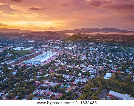 Orange color dusk in Managua city aerial panorama view
