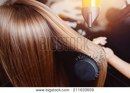 Close-up of hair dryer for hair drying concept hair salon female stylist.