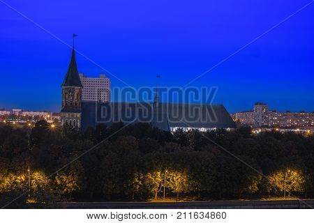 Night cityscape of Kaliningrad Russia. Gothic cathedral in Kaliningrad city formerly Koenigsberg Germany. Beautiful view of Kant Island. Night illumination. The center of city in evening